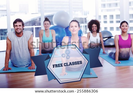 The word free classes and fit class doing the cobra pose in fitness studio against hexagon - stock photo