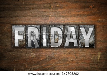 """The word """"Friday"""" written in vintage metal letterpress type on an aged wooden background. - stock photo"""