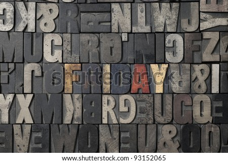 The word Friday written out in old letterpress blocks. - stock photo