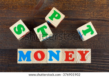 the word from children's wooden blocks with colorful letters on wooden table - stock photo