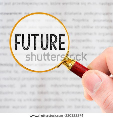 The word FUTURE is magnified.Hand holding magnify glass - stock photo