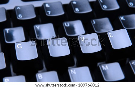 The word Give spelled out on a computer keyboard. Only the keys forming Give are in focus.