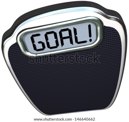 The word Goal on a scale to illustrate you have reached your target weight loss through diet and exercise and are now lighter and healthier - stock photo