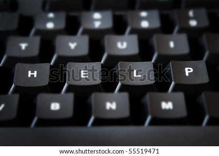 The word HELP spelled-out on computer keyboard - stock photo