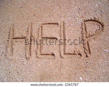 The word help written on a sandy beach in bold. - stock photo