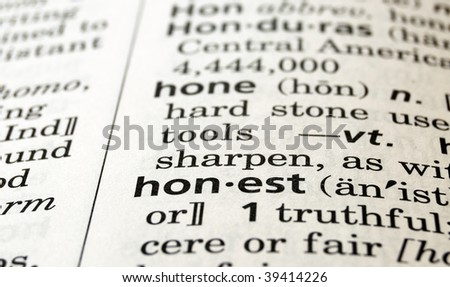 The word honest in a dictionary, close-up - stock photo