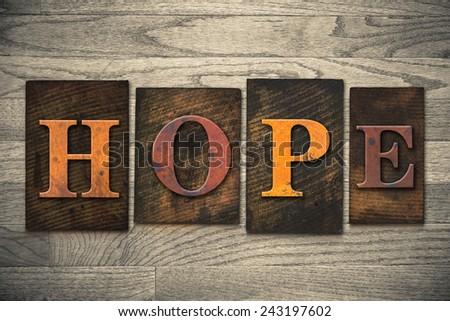 "The word ""HOPE"" written in wooden letterpress type. - stock photo"