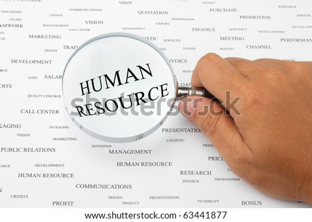 The word HUMAN RESOURCE is magnified. - stock photo