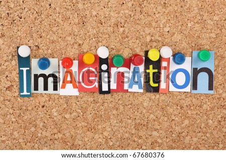 The word Imagination in magazine letters pinned to a cork notice board
