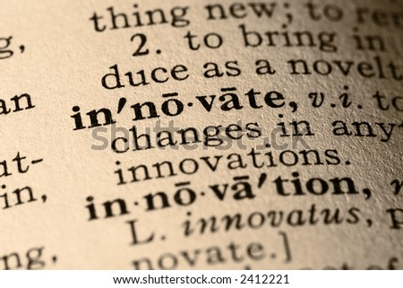 The word innovate. Close-up of the word innovate and innovation in a dictionary. - stock photo