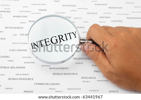 The word INTEGRITY is magnified. - stock photo