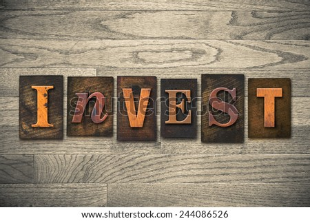 """The word """"INVEST"""" written in wooden letterpress type. - stock photo"""
