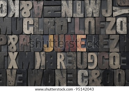 The word June written in antique letterpress printing blocks. - stock photo