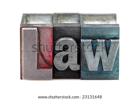The word Law in old letterpress printing blocks isolated on a white background.