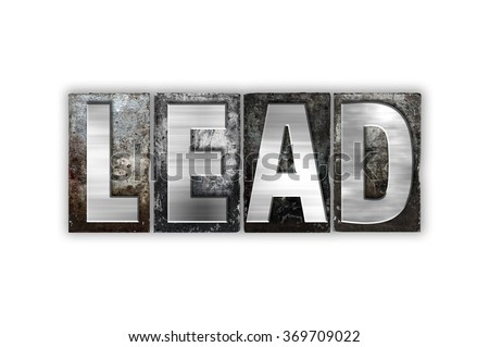 """The word """"Lead"""" written in vintage metal letterpress type isolated on a white background. - stock photo"""