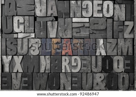The word learn written out in old letterpress blocks. - stock photo
