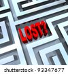 The word Lost in the middle of a maze or labyrinth symbolizing disorientation and not knowing where to turn, having lost your way - stock photo
