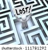 The word Lost on a sign held by a man or person stuck in a maze or labyrinth looking for a way out or to be rescued - stock photo