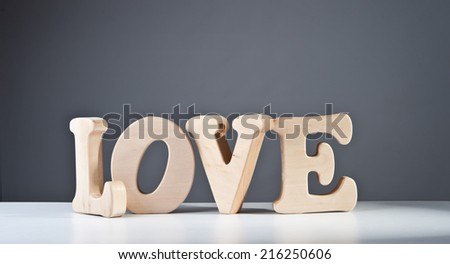 The word love on a gray background. - stock photo