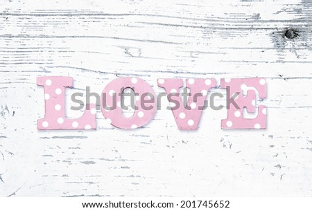the word love on a white background worn - stock photo