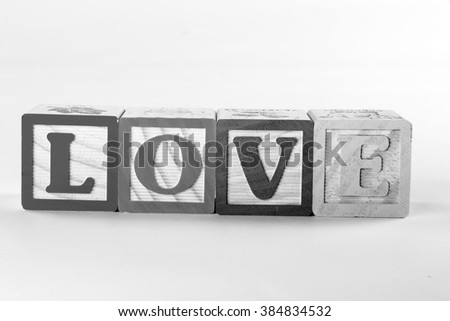 The word love spelled out in wooden children's letter blocks