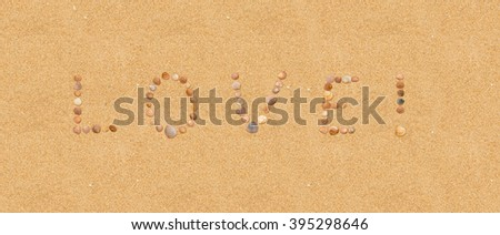 The word Love written on the sandy beach using individual seashells