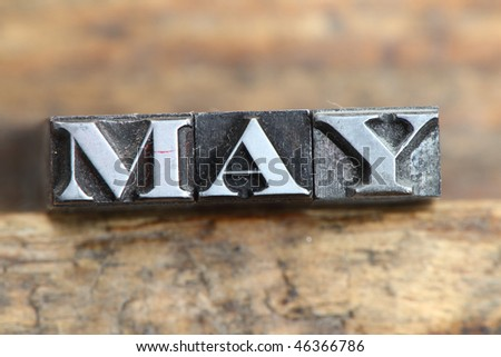 the word may in letterpress type on a wooden background. - stock photo