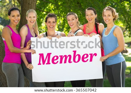 The word member and white wall against fitness group holding poster in park - stock photo