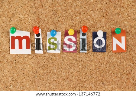 The word Mission in cut out magazine letters pinned to a cork notice board. The word is often used to define the purpose or mission statement of an organization.