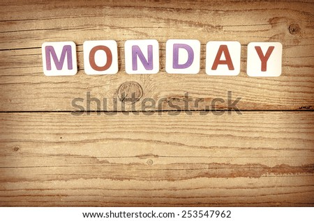 The word MONDAY written in wooden letterpress type. - stock photo