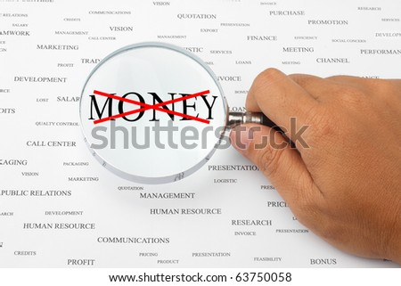 The word MONEY with red cross in magnifying glass.