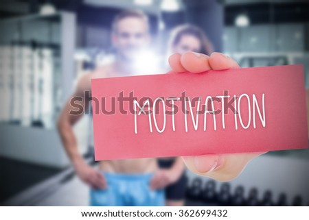 The word motivation and hand showing card against - stock photo