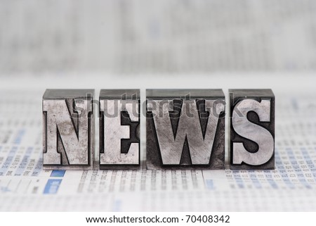 The word news in old plumb letters, which were used to print newspapers in the past. - stock photo