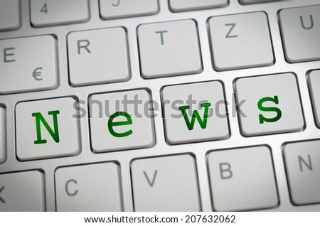 the word news on a keyboard - stock photo