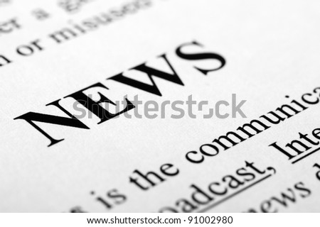 The word news shot with artistic selective focus. - stock photo