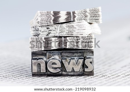 the word news written with lead letters. symbol photo for newsletters, newspapers and information - stock photo