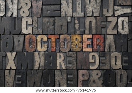 The word October written in antique letterpress printing blocks. - stock photo