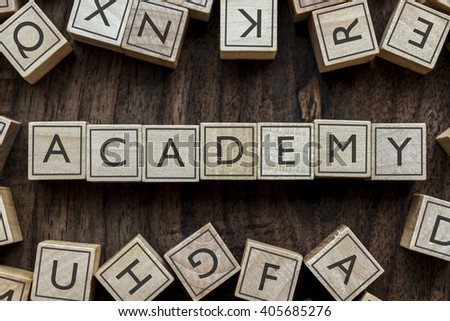 the word of ACADEMY on building blocks concept - stock photo