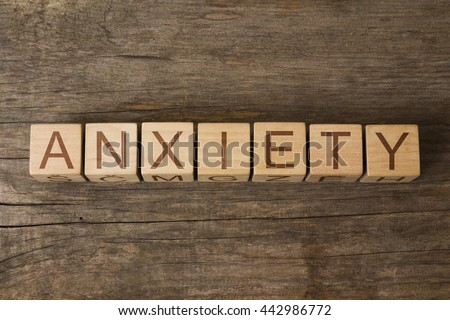 the word of ANXIETY on a wooden cubes