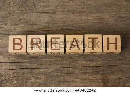 the word of BREATH on a wooden cubes