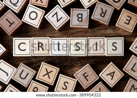 the word of CRISIS on building blocks concept - stock photo