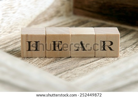 the word of HEAR  on wooden cubes - stock photo