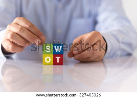 The word of SWOT on Wooden Cubes - stock photo