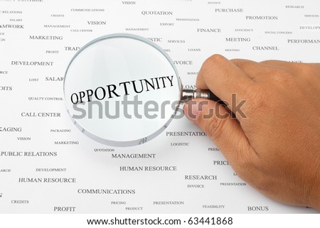 The word OPPORTUNITY is magnified. - stock photo