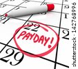 The word Payday circled in red marker on a calendar to remind you of the date you receive your wages, income and earnings so you may budget your finances - stock photo