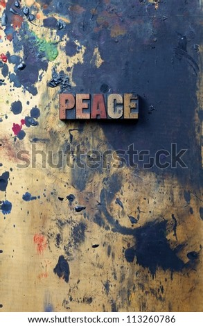 The word peace written in antique letterpress printing blocks. - stock photo