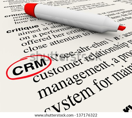 The word, phrase or acronym CRM which means Customer Relationship Management defined in a dictionary with the definition circled by a red marker - stock photo