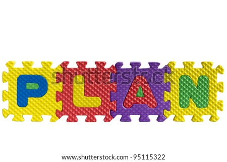 """The word """"Plan"""" written with alphabet puzzle letters isolated on white background - stock photo"""