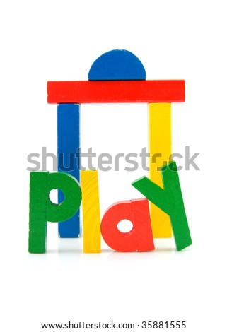the word play and wooden colorful building blocks isolated on white background - stock photo