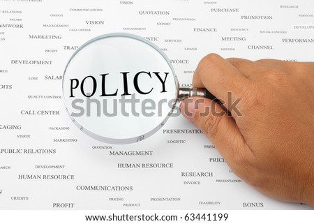 The word POLICY is magnified. - stock photo